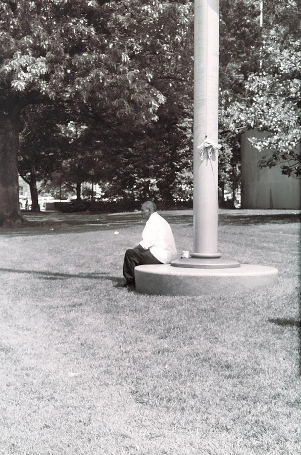 Man Resting At Pole Photograph