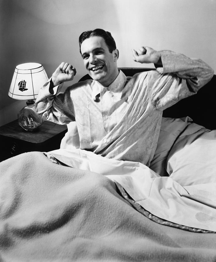 Man Stretching In Bed, (b&w), Photograph