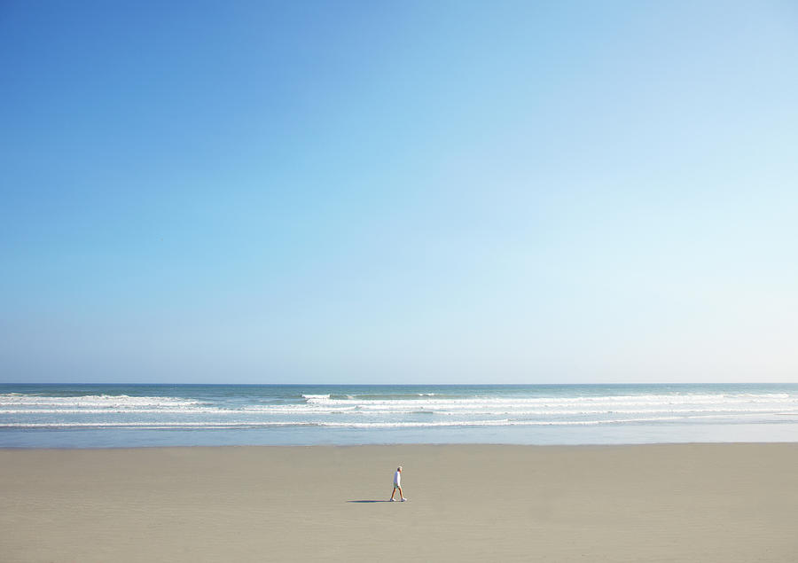 Adult Photograph - Man Walking On Beach by Thomas Northcut