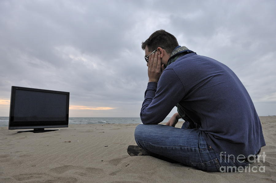 Man With Tv On Beach At Sunset Photograph