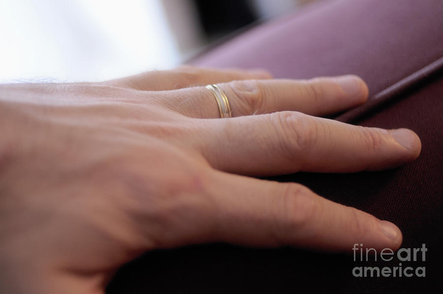 Mans Hand On Sofa With Wedding Ring Photograph