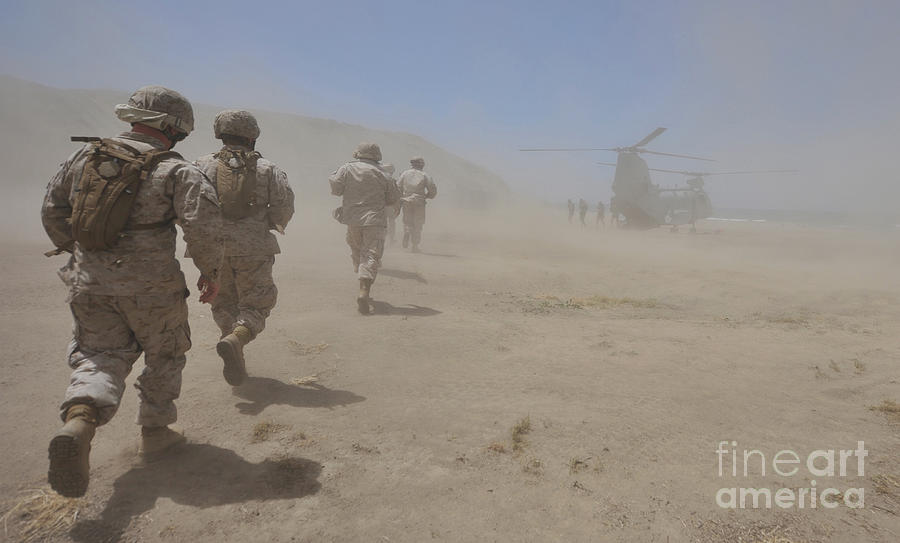 Marines Move Through A Dust Cloud Photograph