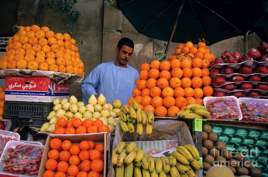 Market Vendor Selling Fruit In A Bazaar Photograph  - Market Vendor Selling Fruit In A Bazaar Fine Art Print