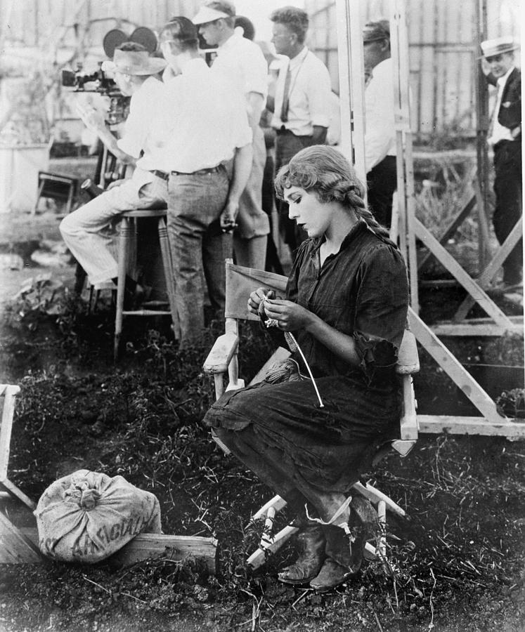 Historical Photograph - Mary Pickford On A Movie Set Knitting by Everett