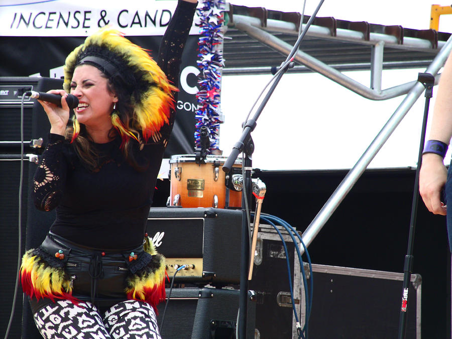 Woman Singer In Mary Jane Band With Indian Native Feathers On Photograph - Maryjane Sings Loud And Proud by Kym Backland