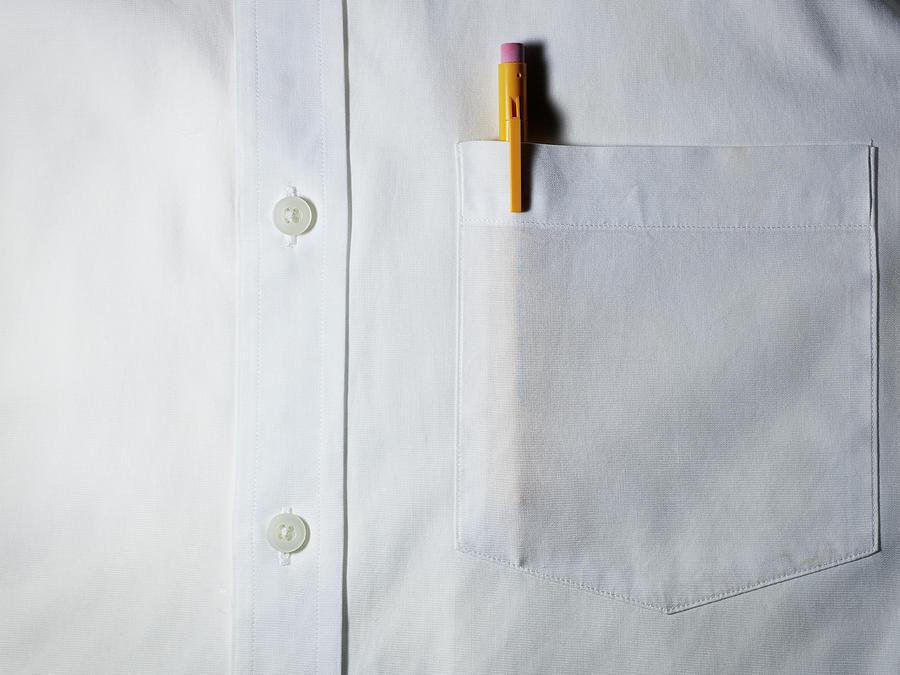 Horizontal Photograph - Mechanical Pencil In White Shirt Pocket. by Ballyscanlon