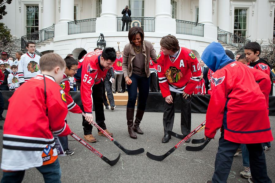Michelle Obama Holds A Lets Move Photograph  - Michelle Obama Holds A Lets Move Fine Art Print