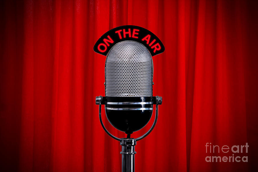 Microphone On Stage With Spotlight On Red Curtain Photograph