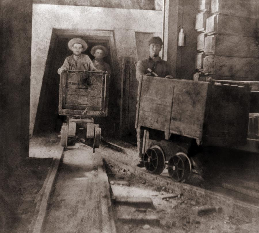Miners Pushing Ore Carts Photograph