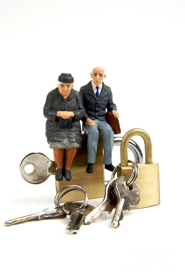 Miniature Figurines Of Elderly Couple Sitting On Padlocks Photograph  - Miniature Figurines Of Elderly Couple Sitting On Padlocks Fine Art Print