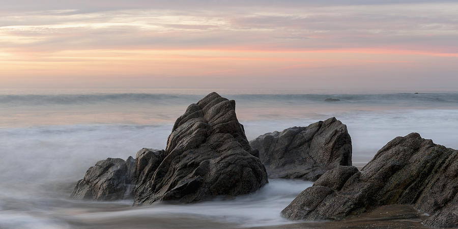 Mist Surrounding Rocks In The Ocean Photograph