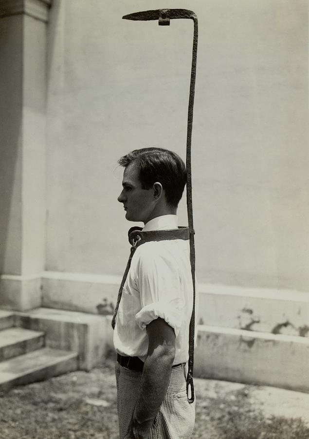 Model Wears A Slave Bell Rack, A Used Photograph