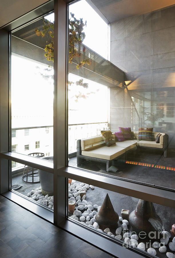 Modern Sofa And Sculptures Photograph