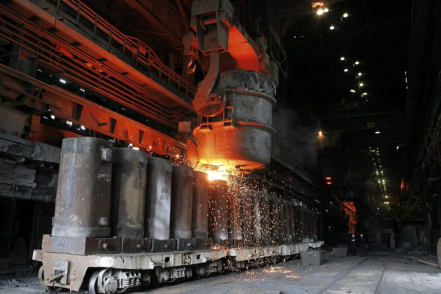 Equipment Photograph - Molten Metal Being Poured Into Vats by Ria Novosti