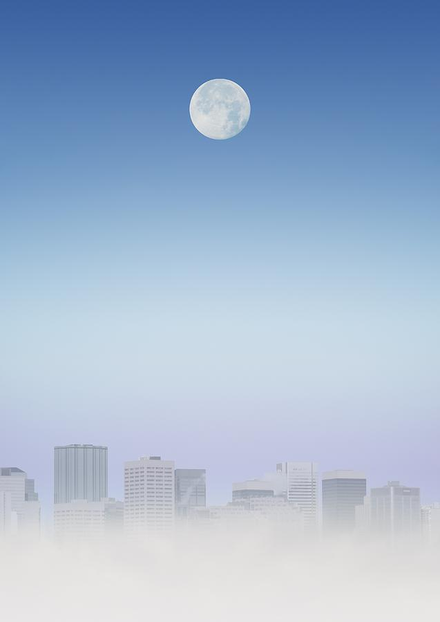 Moon Over Buildings Photograph