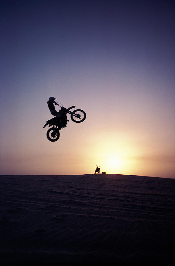 Motorcyclist In Mid-air Jump Photograph