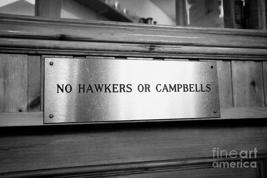 no hawkers or campbells sign in the clachaig inn site of the massacre of glencoe Scotland UK  Photograph
