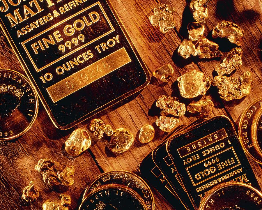 Nuggets, Bars And Coins Made Of Gold Photograph