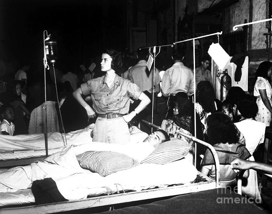Nurse Adjusts Glucose Injection Photograph