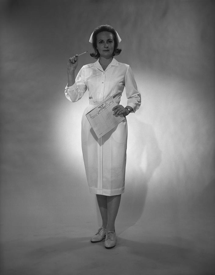 Nurse Holding Medical Chart Posing In Studio, (b&w), Portrait Photograph