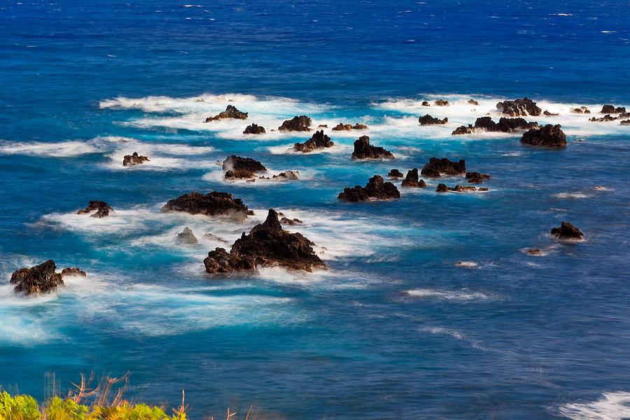 Ocean Waves Blur Against The Lava Rocks Photograph