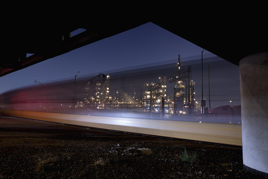 Oil Refinery And Train Blur Photograph