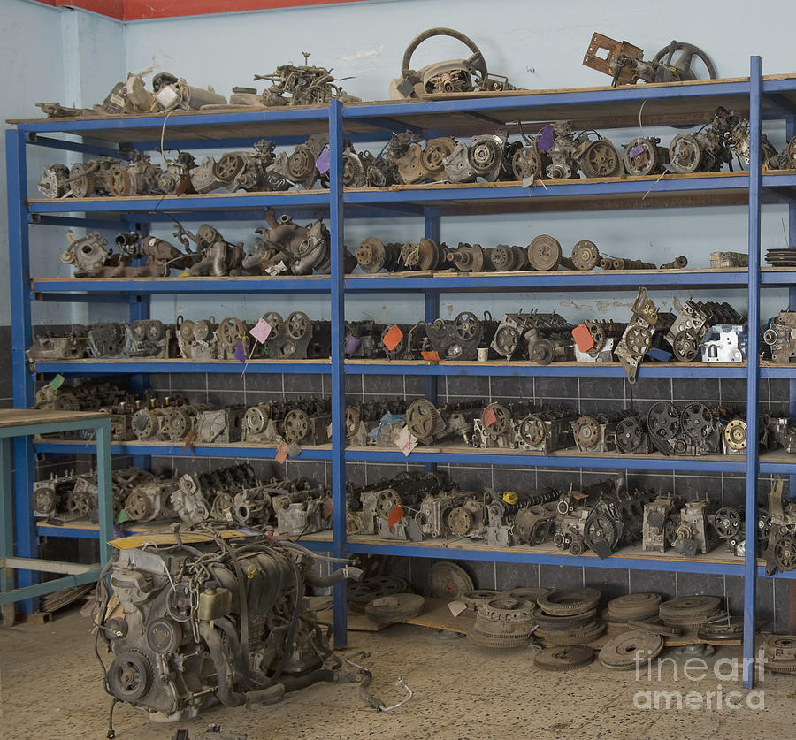 Old Automobile Parts On Shelves Photograph