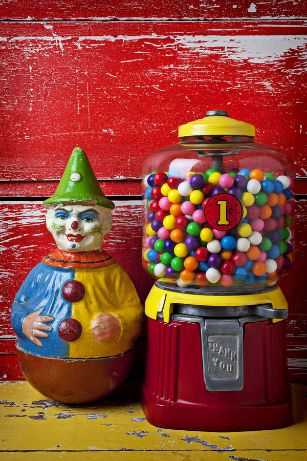 Old Clown Toy And Gum Machine  Photograph