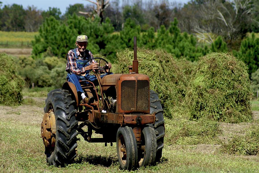 Farmer On Tractor : Old farmer in field on tractor by danny jones