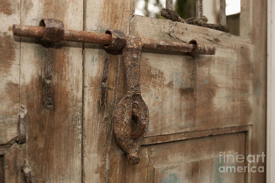 Old Iron Door Latch On Wooden Door Photograph by Will & Deni McIntyre