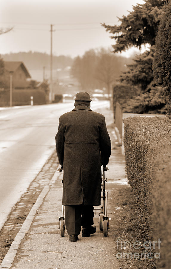 Old Man Alone Walking Along Rural Street Photograph