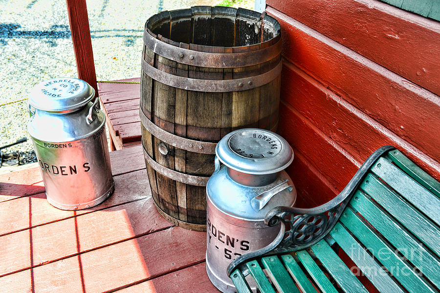 Old Milk Cans And Rain Barrel. Photograph
