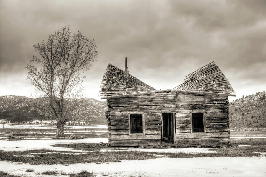 Old Rustic Log Cabin In The Snow Photograph