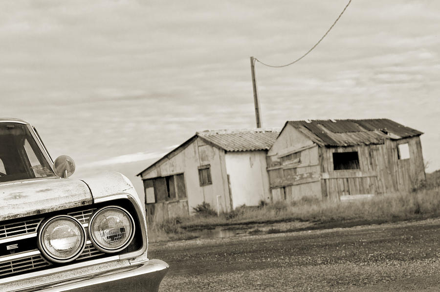 Black And White Photos Photograph - Olds Cutlass 63 Headlights And Huts Bw by Philippe Taka