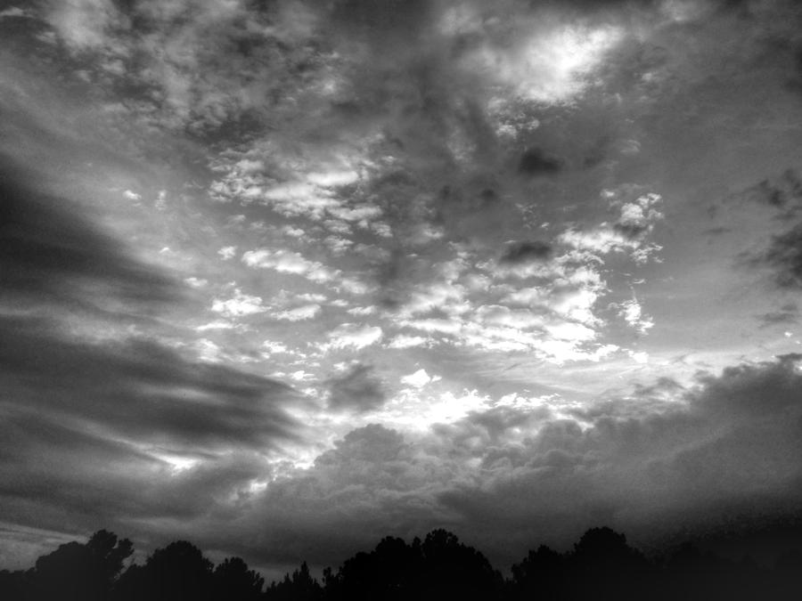 Clouds photograph on a cloudy day in black and white by kathy clark