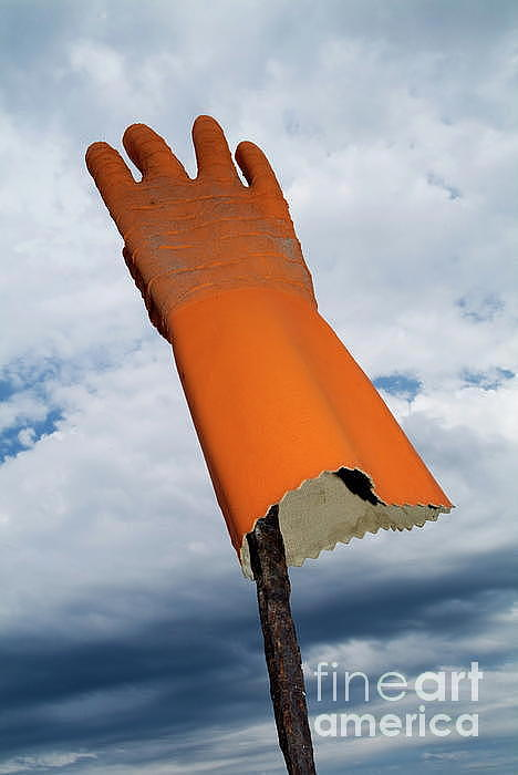 Orange Rubber Glove On A Wooden Post Against A Cloudy Sky Photograph  - Orange Rubber Glove On A Wooden Post Against A Cloudy Sky Fine Art Print