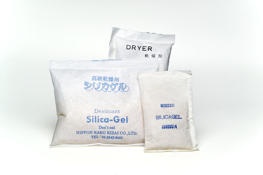 Silica Gel Photograph - Packets Of Silica Gel by Paul Rapson
