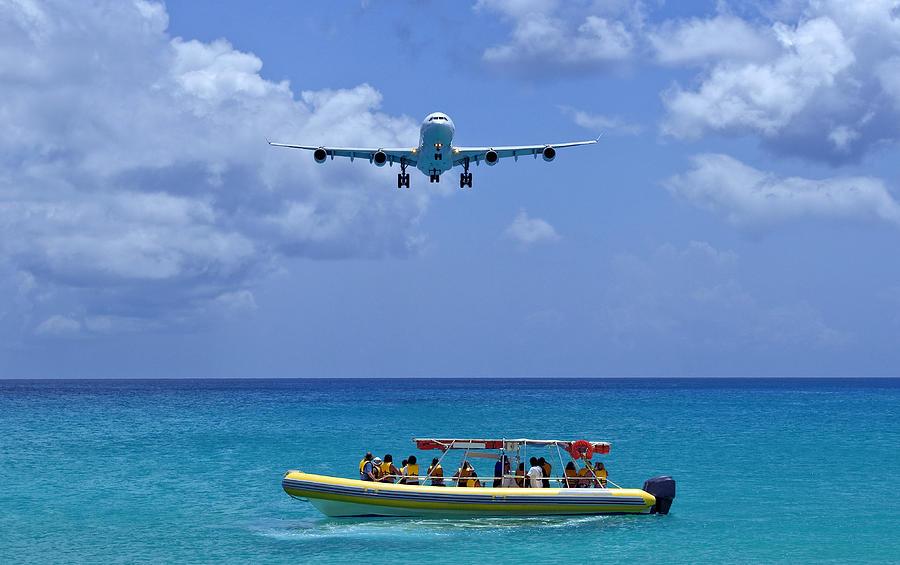 Passenger Airplane Overflies Boat. Photograph