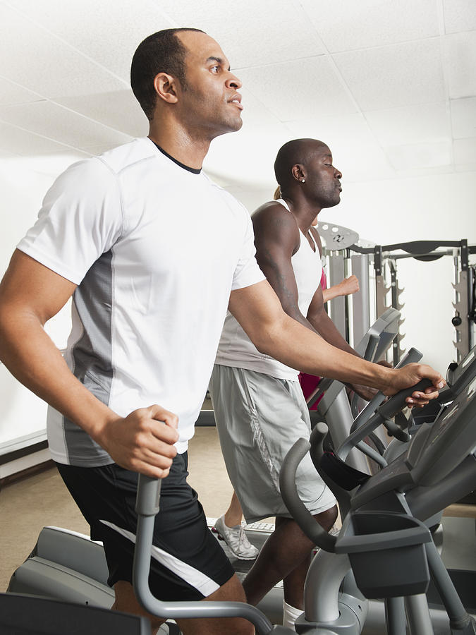 People Exercising In Health Club Photograph