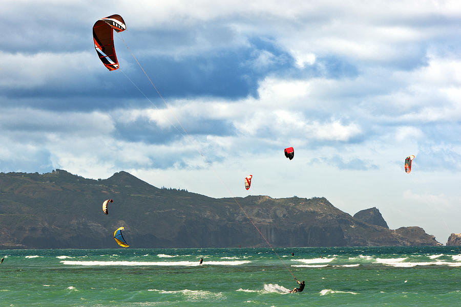 People Kiteboarding Along Coast Photograph