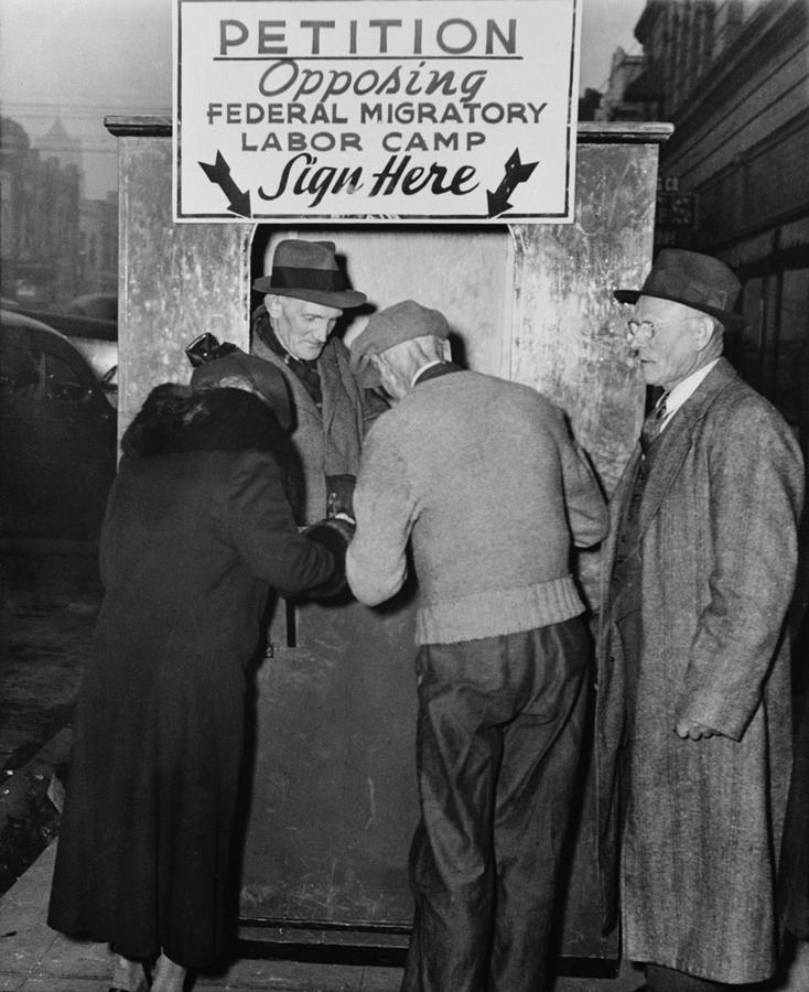 People Sign A Petition Opposing Photograph