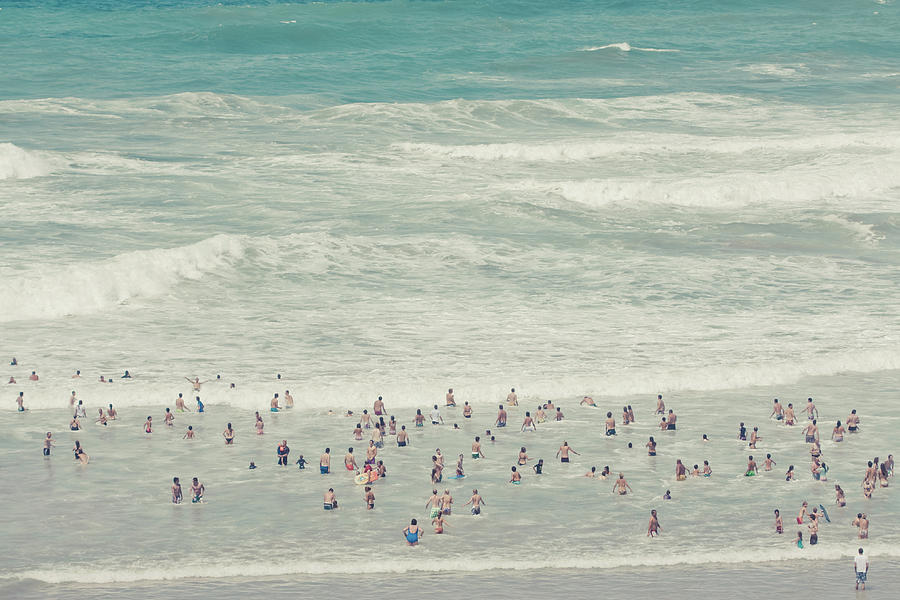 People Walking Into Ocean Photograph