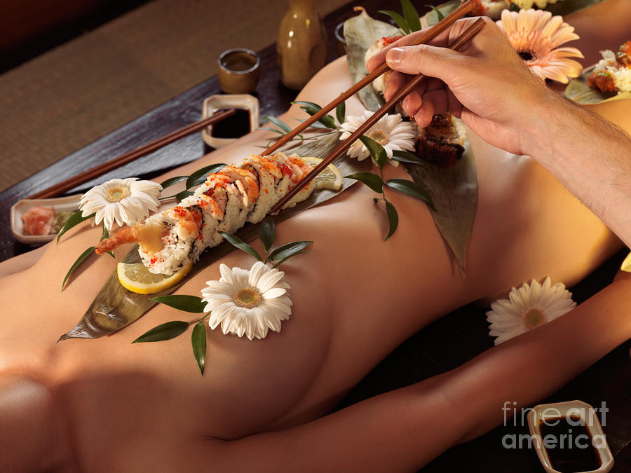 Person Eating Nyotaimori Body Sushi Photograph