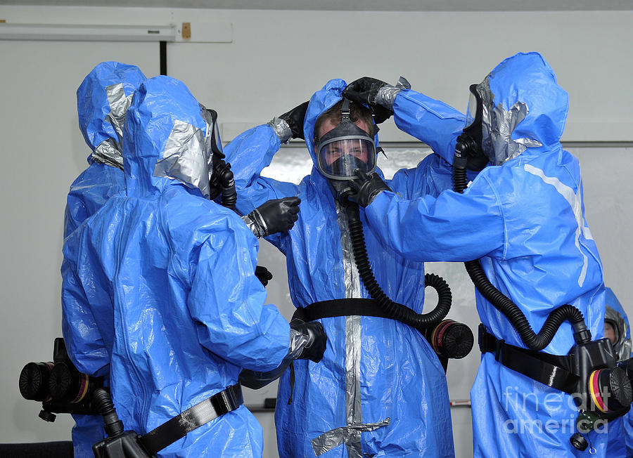 Military Photograph - Personnel Dressed In Hazmat Suits by Stocktrek Images