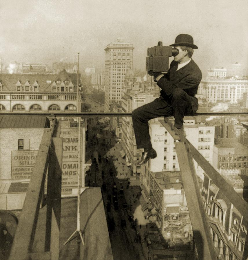 Photographer Perched On Slender Beam 18 Photograph