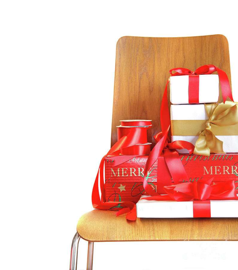Pile Of Gifts On Wooden Chair Against White Photograph  - Pile Of Gifts On Wooden Chair Against White Fine Art Print