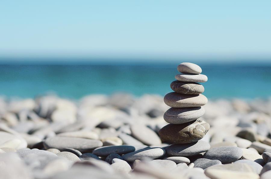 Pile Of Stones On Beach Photograph