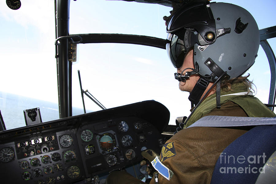 Transportation Photograph - Pilot In The Cockpit Of A Ch-46 Sea by Daniel Karlsson