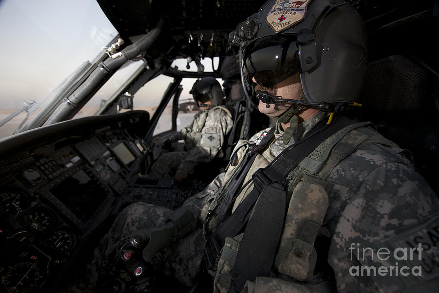 Pilot In The Cockpit Of A Uh-60l Photograph