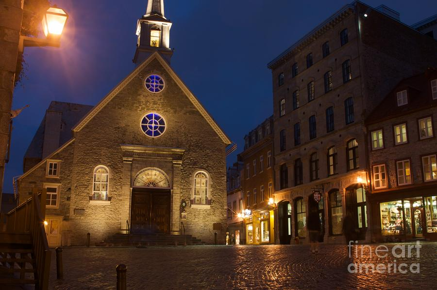 Place Royale And Notre-dame-des-victoires Church At A Rainy Evening Photograph